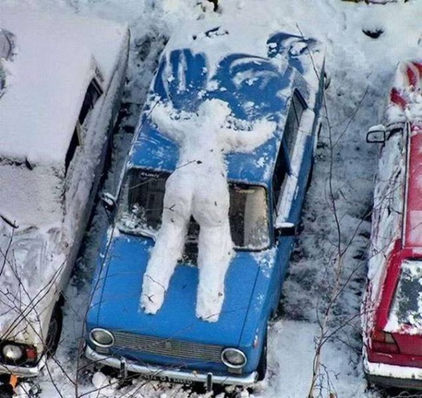 snow person on car