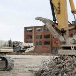 scrap yard with electromagnetic crane